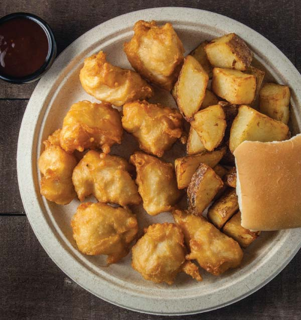 Chicken Bites with potatoes, bread and barbecue sauce