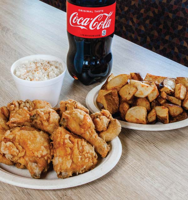 Golden-fried Chicken, potatoes, slaw, and a 2-liter of Coca-Cola